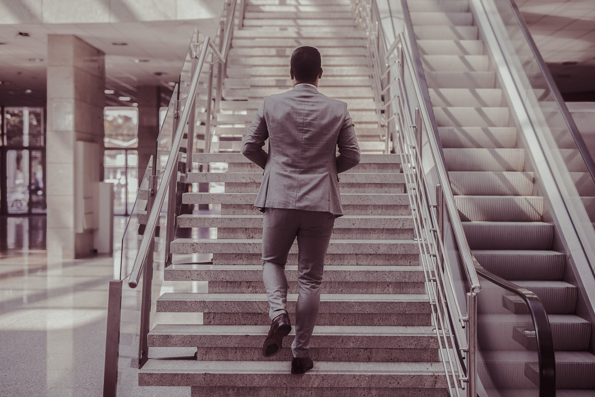 Business man walking up stairs