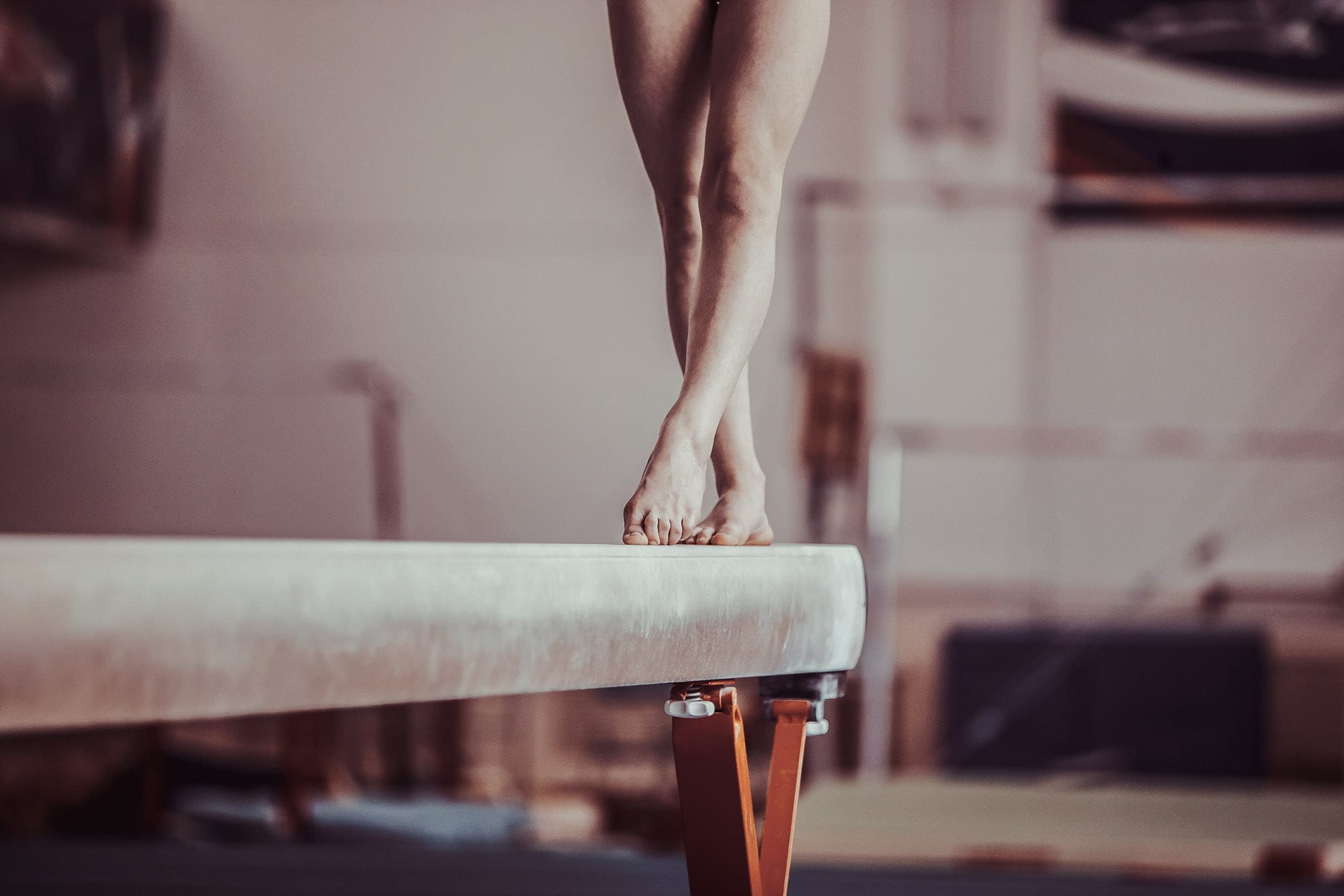 Gymnast Balancing on beam