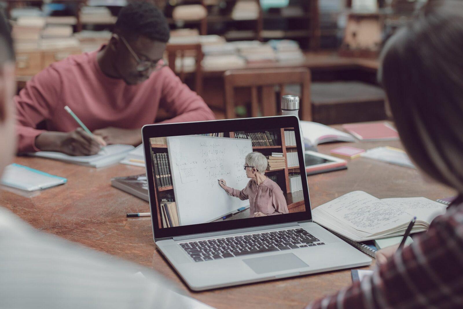 Watching teacher on laptop